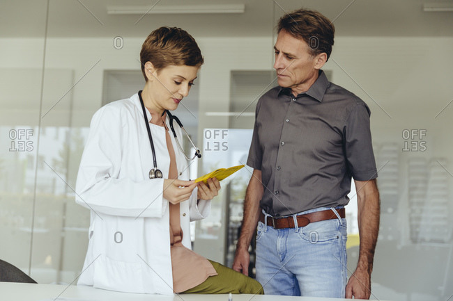 female looking at immunization card of worried patient