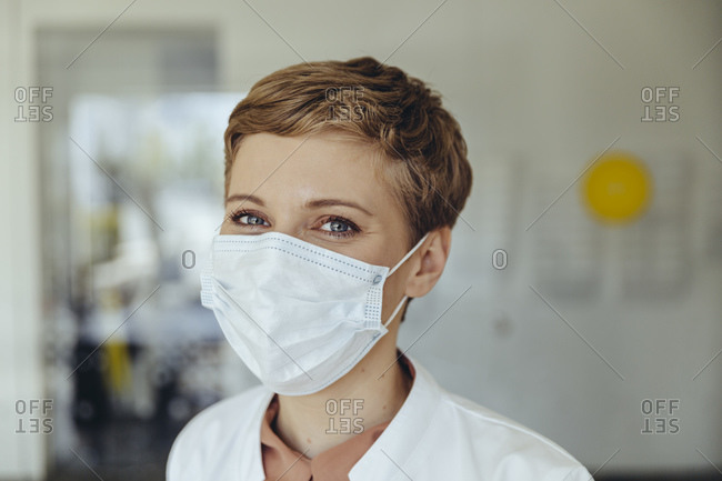Portrait of a confident female doctor- wearing surgical mask