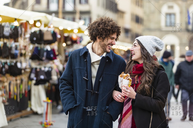 Happy young couple strolling at Christmas market