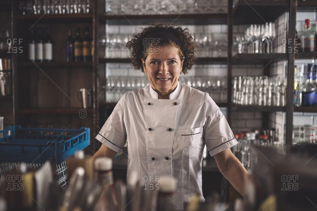 Portrait of smiling female chef in commercial kitchen