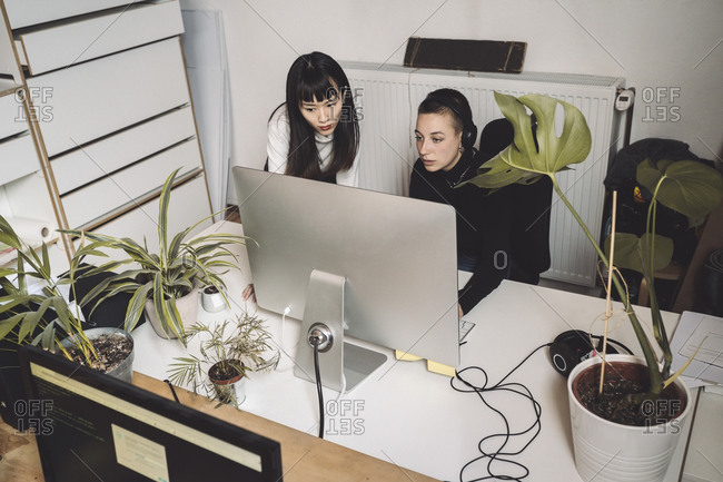 Businesswomen working on computer at place of work