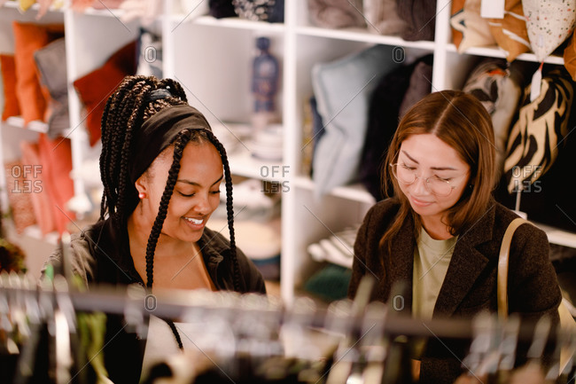 High angle view of friends talking while shopping at retail store