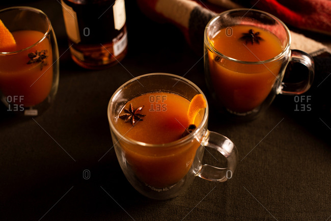 Mulled apple cider and orange cocktails with cinnamon and star anise spices