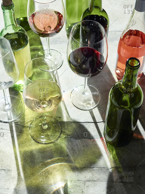 Variety of wines in glasses and bottles