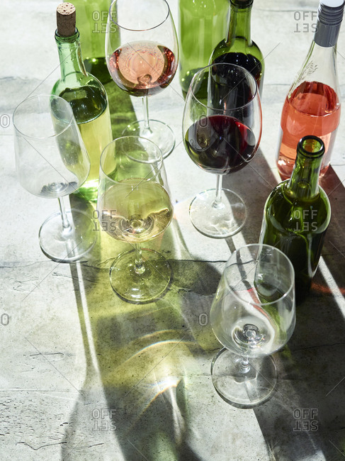 Various wines in glasses and bottles