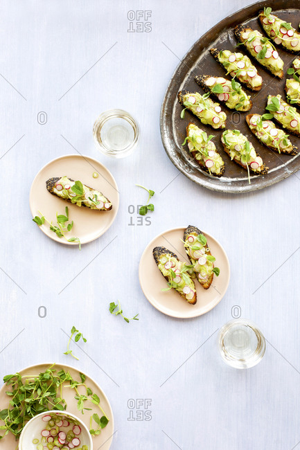 Radish fennel manchego crostini with fresh pea pesto