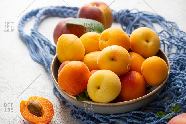 Bowl full of apricots and peaches