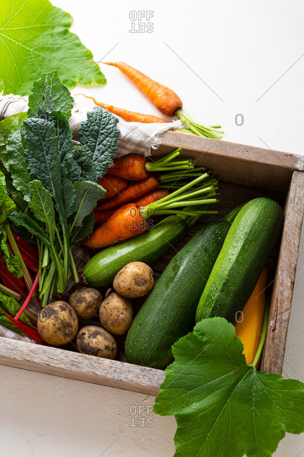 Fresh organic produce in wooden a crate