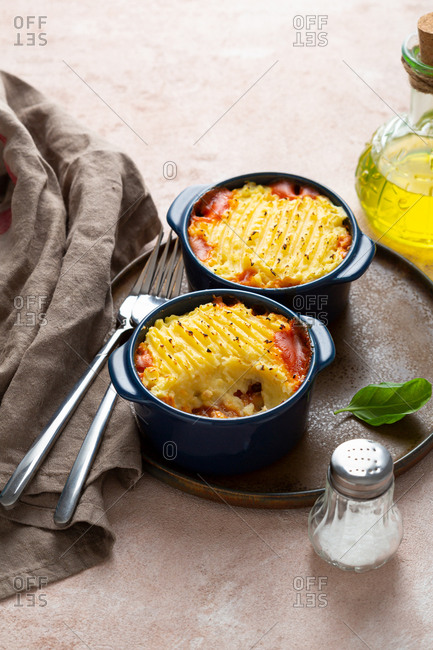 Two dishes of potato casserole