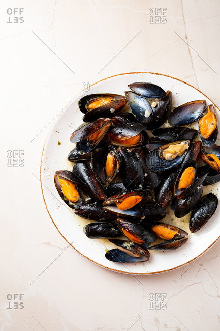 Overhead view of mussels with sauce