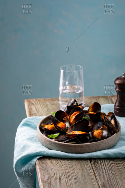 Mussels with sauce on wooden table