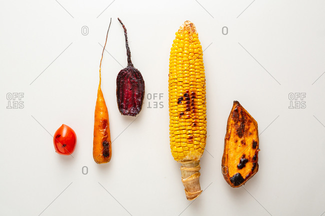 Overhead view of roasted vegetables on light surface