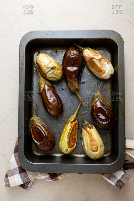 Roasted eggplants on baking sheet