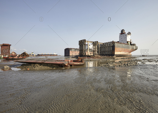 Partially disintegrated ocean ships at the Chittagong Ship Breaking Yards, Bangladesh