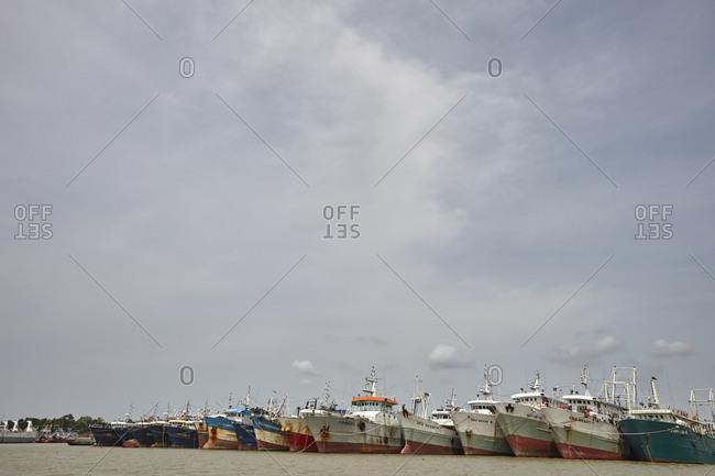 Chittagong, Bangladesh - May 11, 2013: Rusty ships anchored at the Bangla Bazar Ghat of the River Karnaphuli not far from Chittagong, Bangladesh