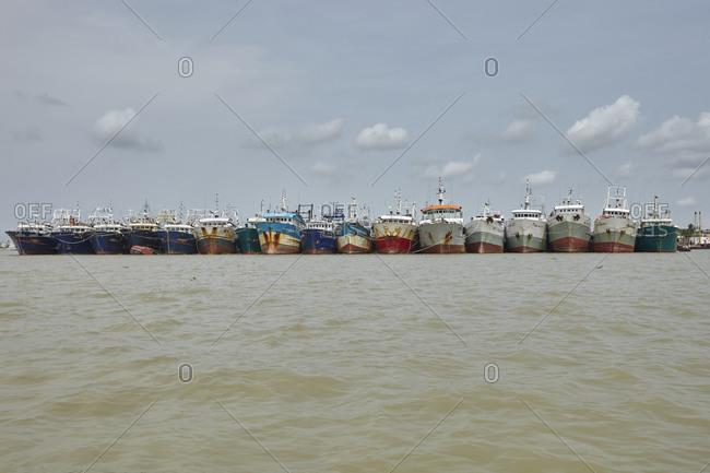 Chittagong, Bangladesh - May 11, 2013: Large old ships anchored at the Bangla Bazar Ghat of the River Karnaphuli not far from Chittagong, Bangladesh