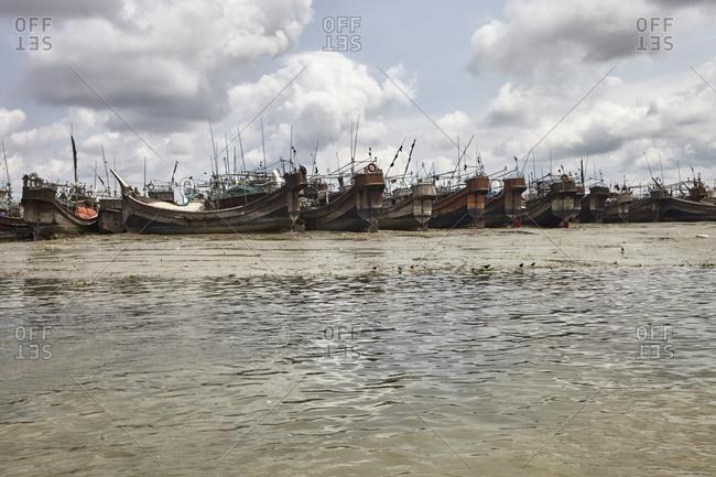 Ancient looking and abandoned ships anchored on the River Karnaphuli not far from Chittagong, Bangladesh