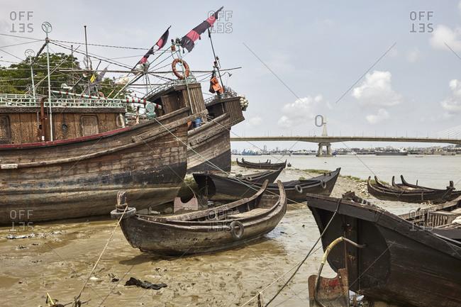 Abandoned ancient looking ships and boats anchored at River Karnaphuli, Chittagong, Bangladesh