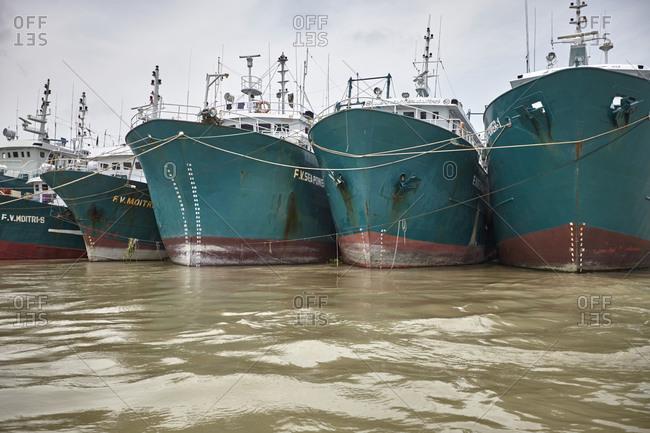 Chittagong, Bangladesh - May 11, 2013: Ships anchored at the Bangla Bazar Ghat of the River Karnaphuli near Chittagong