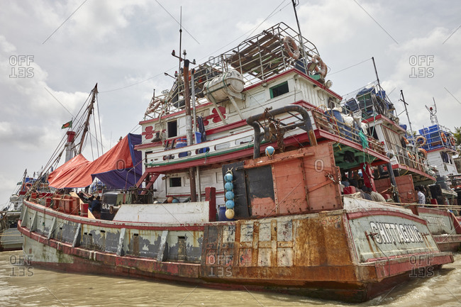 Chittagong, Bangladesh - May 11, 2013: Ship crew members doing maintenance work on their ship while moored on the Karnaphuli River not far from the Bay of Bengal
