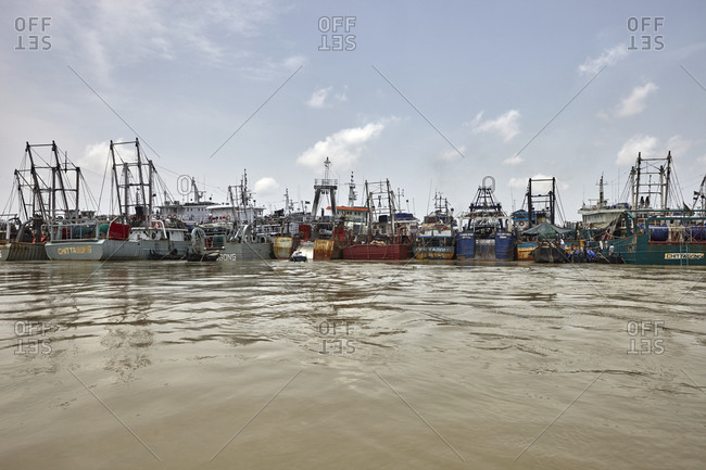 Chittagong, Bangladesh - May 11, 2013: Abundance of large ships anchored at the Bangla Bazar Ghat of the River Karnaphuli not far from Chittagong