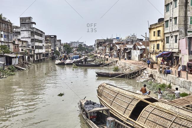 Chittagong, Bangladesh - May 13, 2013: View of old wooden boats anchored at Chaktai Khal on River Karnaphuli, Chittagong, Bangladesh
