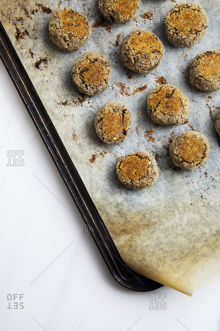Overhead angle of baked vegan meatballs on a baking sheet
