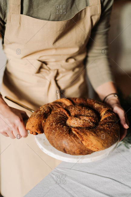 Baker serving a homemade bread loaf for a holiday party