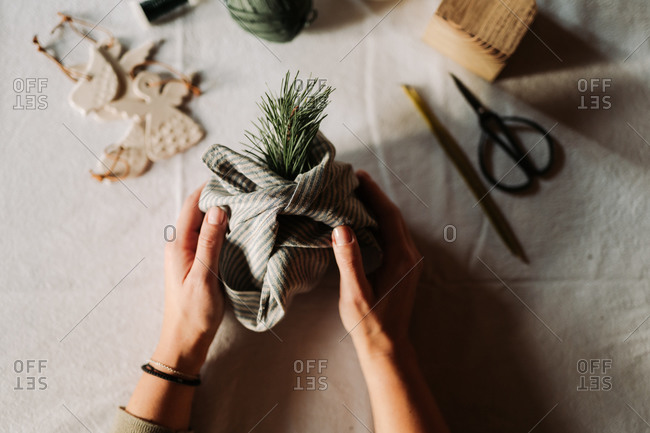 Woman's hands holding a homemade Christmas decoration