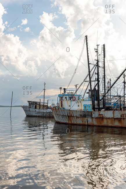 Old rusty boats in marina