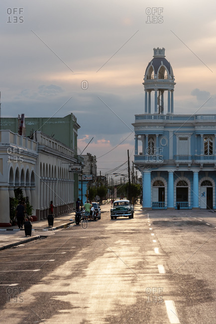 August 28, 2019: House of culture colonial mansion and classic car.  Cienfuegos, Cuba