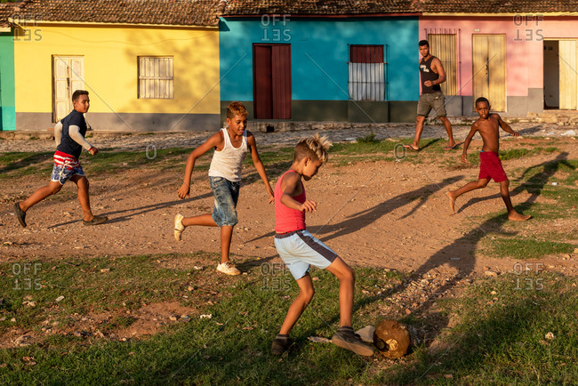 August 24, 2019: Cuban children playing football on waste ground. Trinidad, Cuba