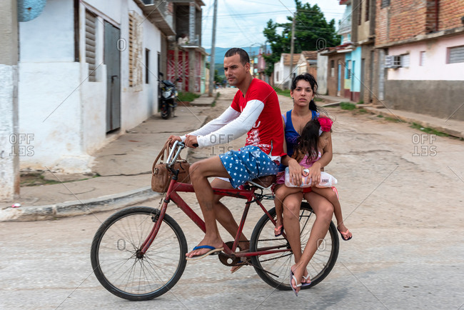 August 25, 2019: Family traveling on the same bike. Trinidad, Cuba