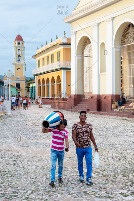 August 25, 2019: Musician carrying a conga with the flag of Cuba. Trinidad, Cuba