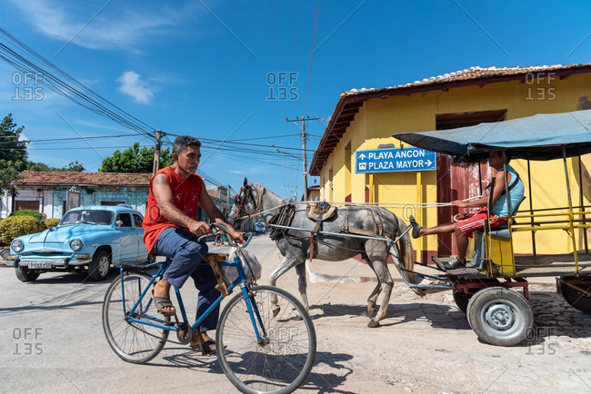 August 26, 2019: Street scene with an old American car on the cobblestone street. Trinidad, Cuba