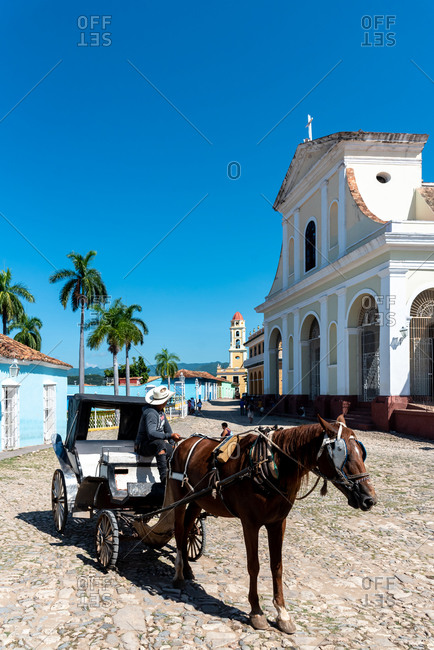 "August 27, 2019: Horse carriage in Main Square called ""Plaza Mayor"". Trinidad, Cuba"