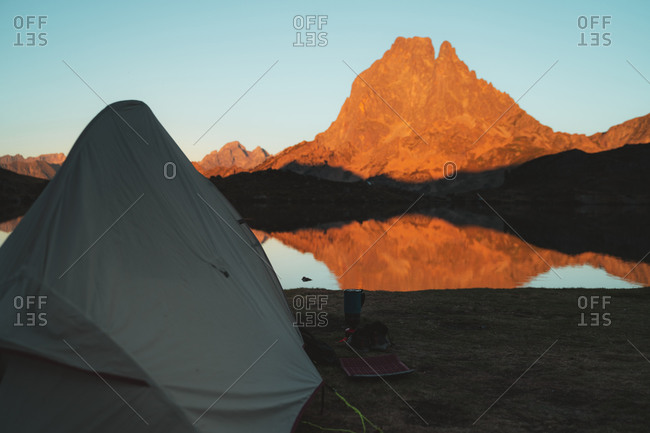 Tent set on the shore of Ayous Lake during sunset