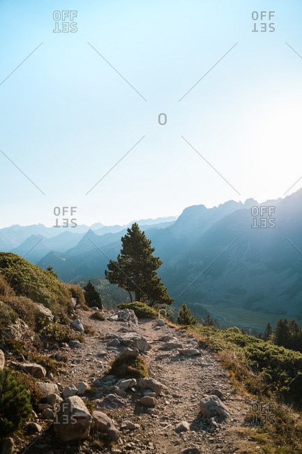 Rocky trail in French Pyrenees with beautiful layers of mountains in the background