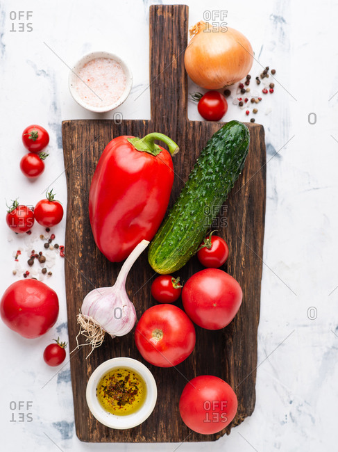 Set of various fresh vegetables and spices for cooking tomato soup gazpacho over white background