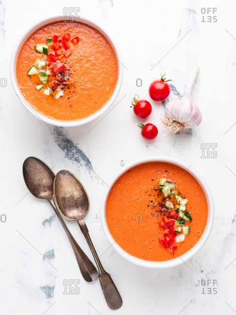 Gazpacho vegetarian soup with fresh cucumber bell pepper and garlic on white background. Spanish cuisine