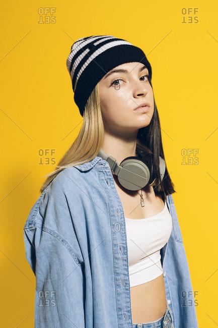Young expressive girl wearing headphones.