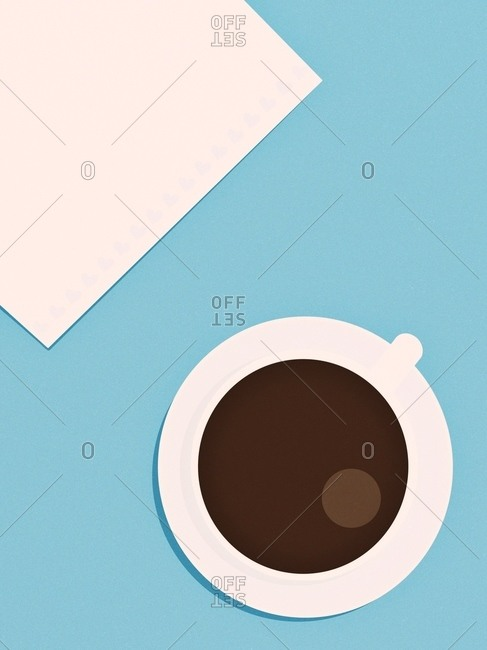 Top view of americano and white napkin on blue textured background