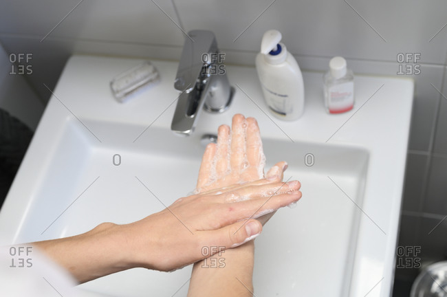 Person washing hands. Detailed shot.