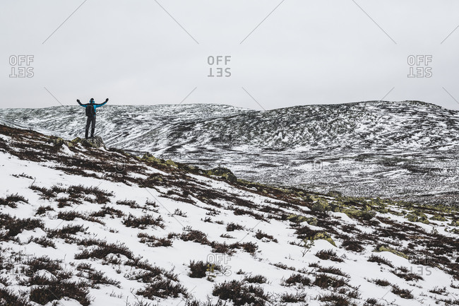 Hiker in mountains at winter. Detailed shot.