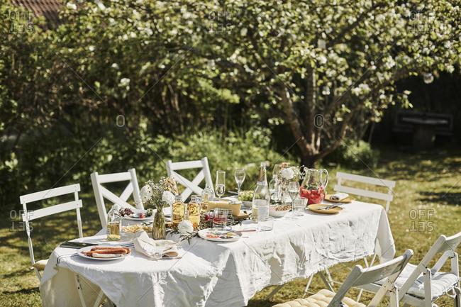 Table set in garden. Detailed shot.