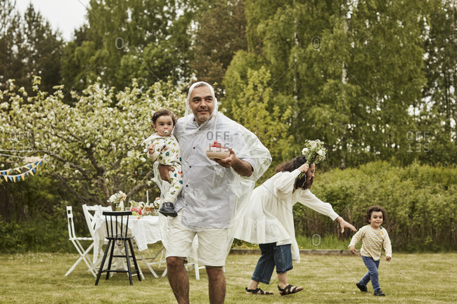 Happy family with kids in garden