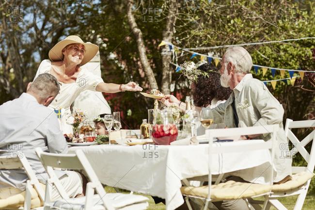 Family having party in garden. Detailed shot.