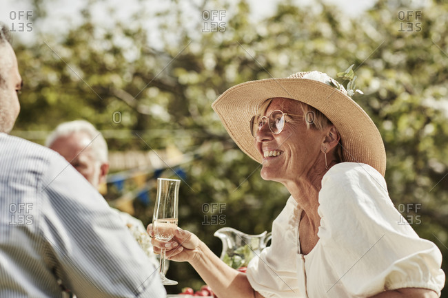Woman smiling at party in garden