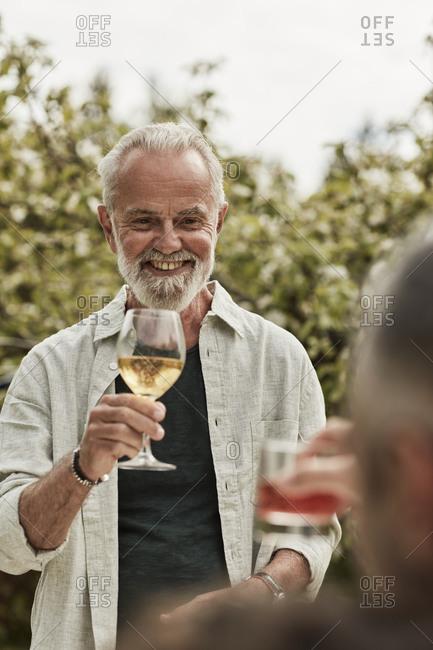 Happy man having glass of wine