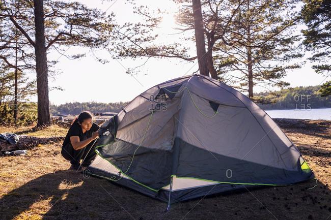 Woman checking tent. Detailed shot.